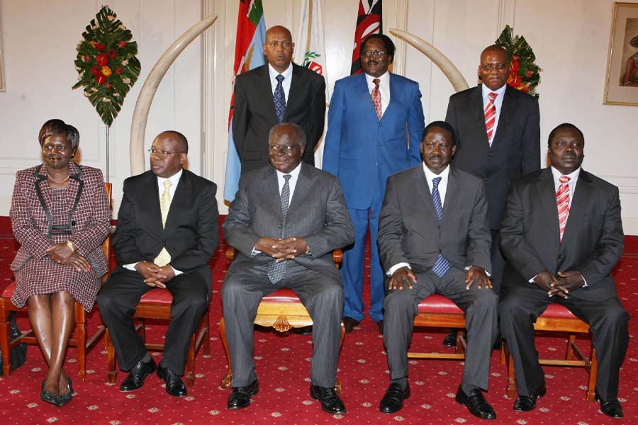 Assistant Minister of Trade Manson Oyongo at State with President Mwai Kibaki and ODM leader Raila Odinga